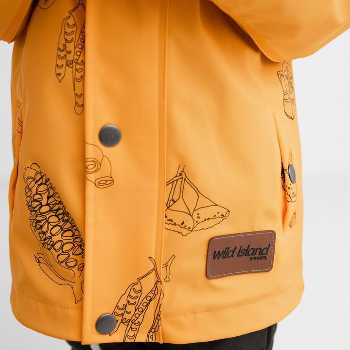 Kids waterproof jacket in mustard yellow with Australian seed pods print and Wild Island brand patch