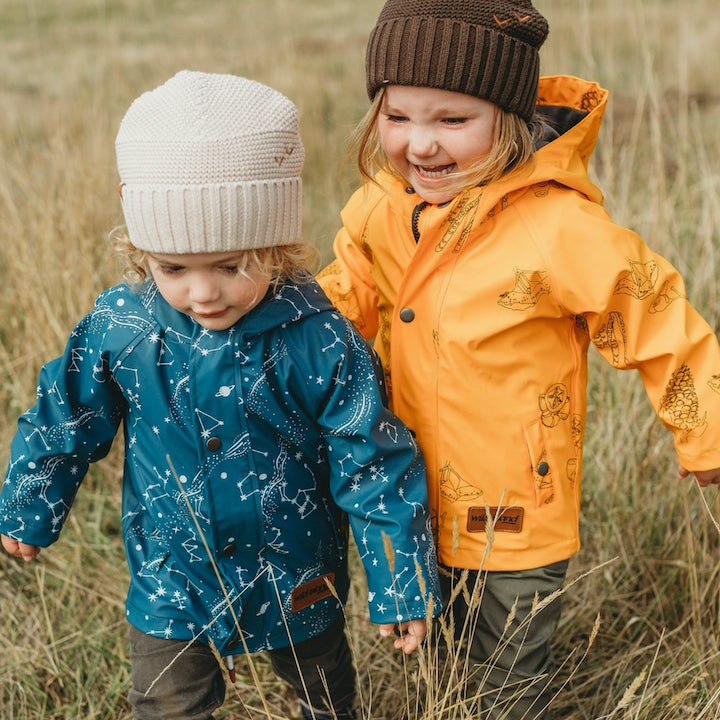 Boy and girl wearing Australian brand Wild Island kids raincoat on an outdoor adventure