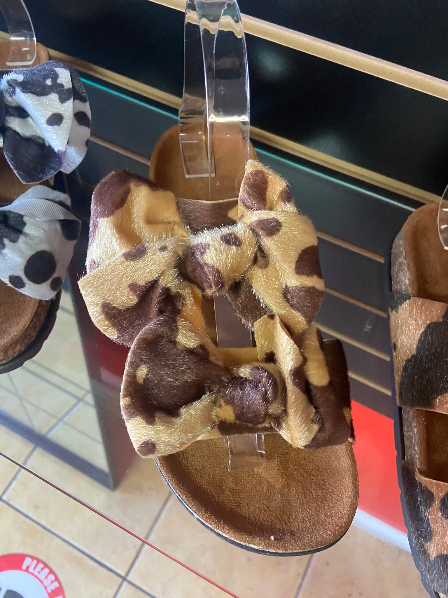 Cow print bow tie slippers