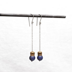Long sterling silver chain earrings with brass and blue Lapis Lazuli beads on bottom.