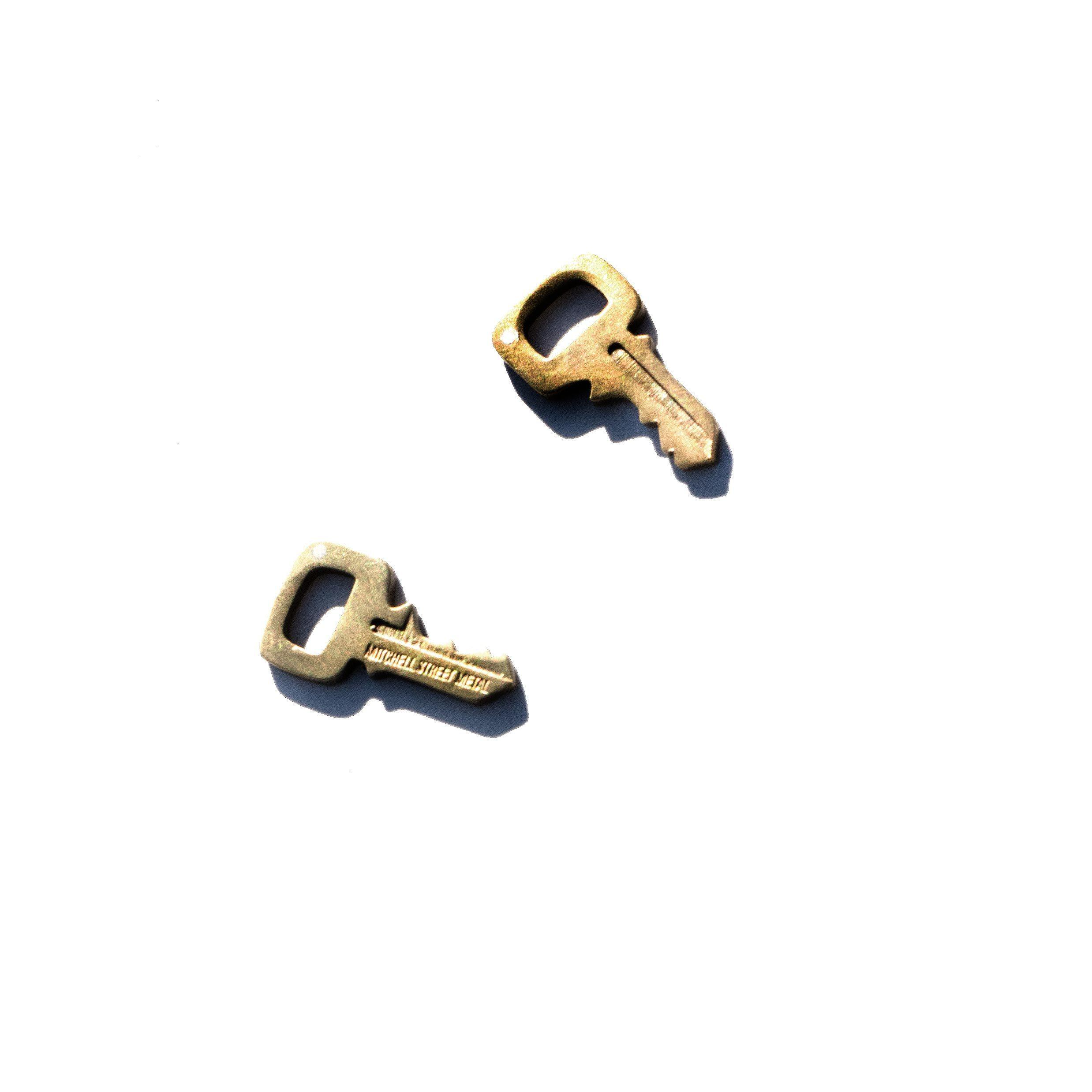 Brass key studs on white background