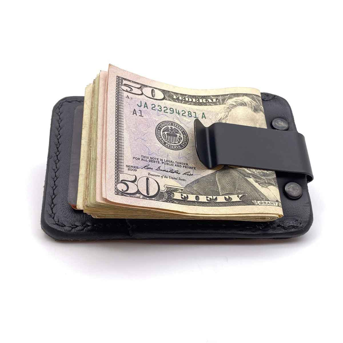 Back side of Black Bridle leather minimalist wallet with money in clip