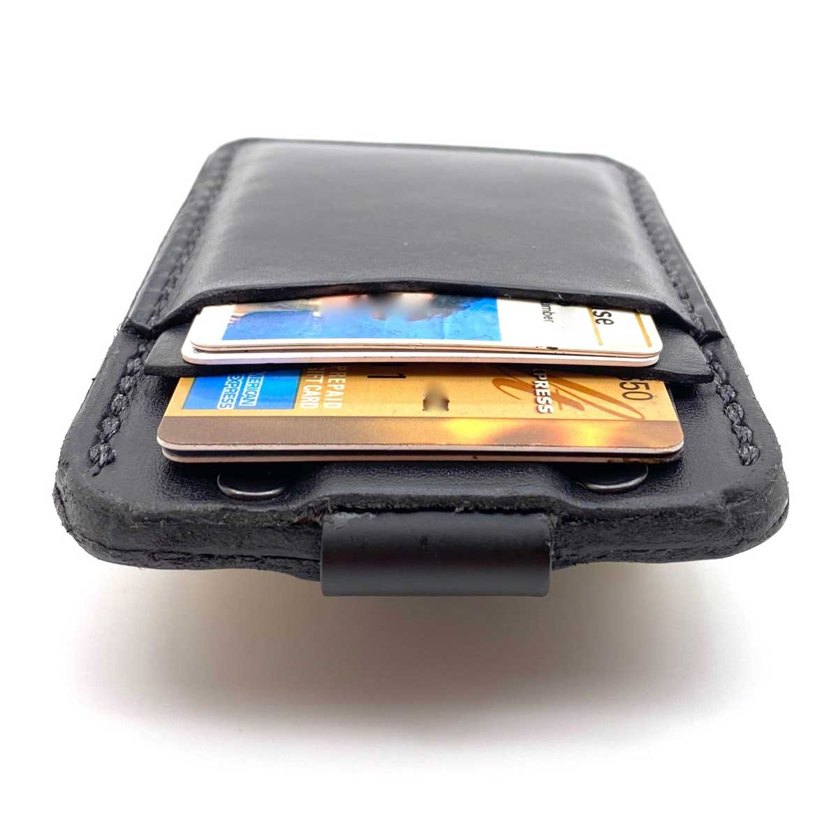 Top side of Black Bridle leather minimalist wallet with credit cards in pockets