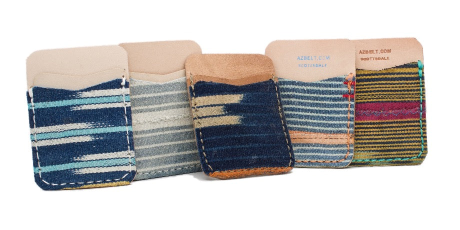 Frontside of 5 adhesive phone wallets made of different African Mud Clothes and natural leather