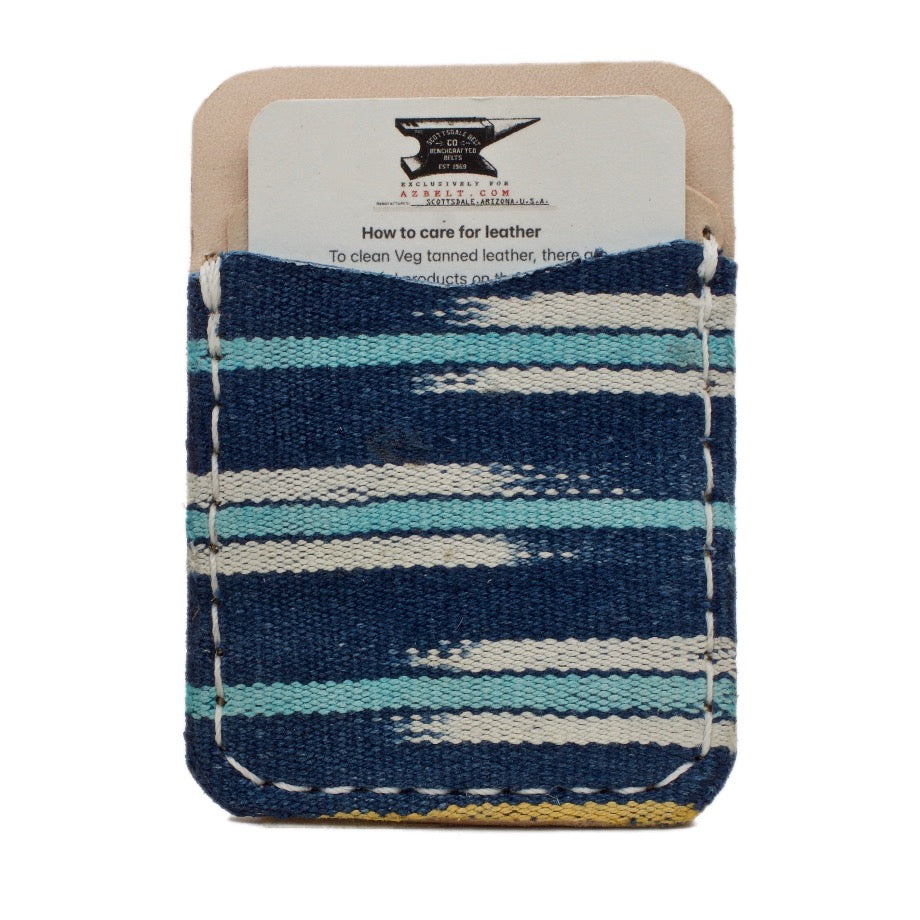 Frontside of Nantucket adhesive Phone Wallet  handcrafted with navy, aqua and white African Mud Cloth and Natural Vegetable Tanned Full Grain Leather