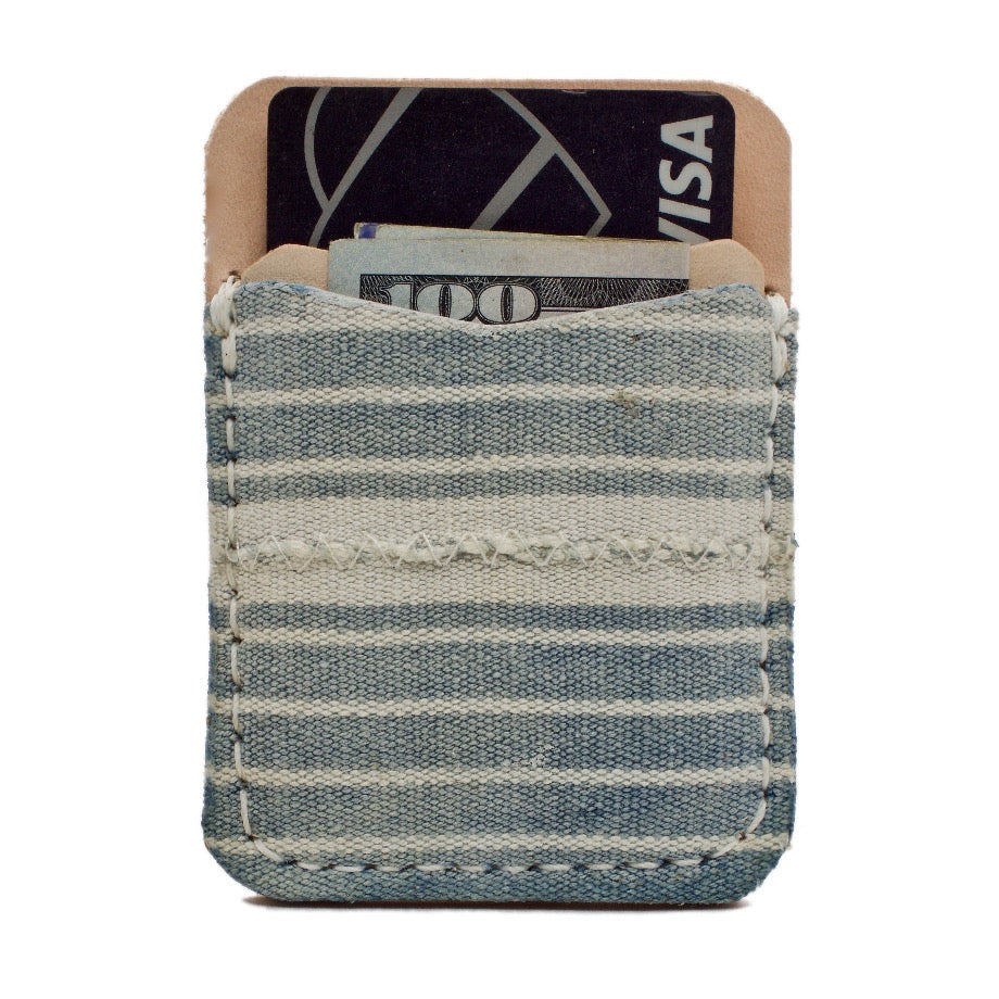 Frontside of the Edisto Adhesive Leather Phone Wallet handcrafted using Authentic Faded Indigo African Mud Cloth and Natural Leather