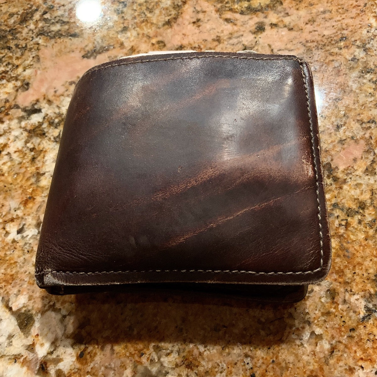 example: 8 year old wallet showing no signs of breakdown