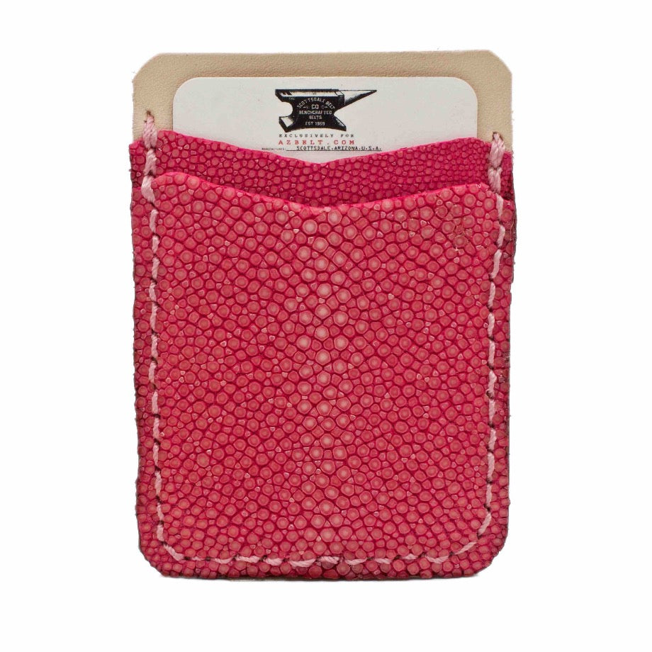 Front side of Raspberry Stingray Stick on Phone Wallet handcrafted with authentic stingray and natural vegetable tanned leather.
