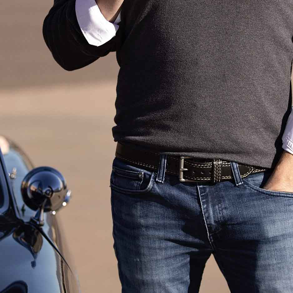Man in blue jeans wearing Remington Mens Black Leather Belt with Stainless Steel buckle