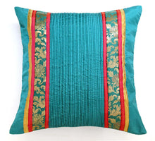 ANS Teal pin tucked cushion with floral brocade.