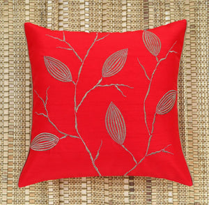 ANS Red Dry Leaves Emb Cushion Cover with gold piping at sides.