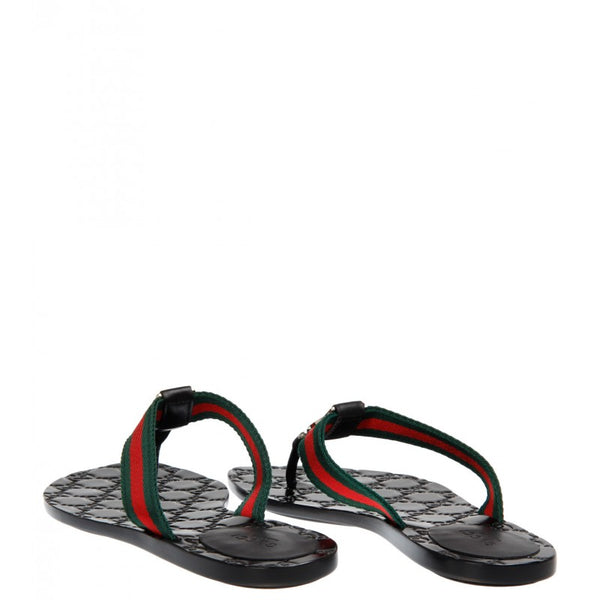 Black leather Guccissima flip-flop