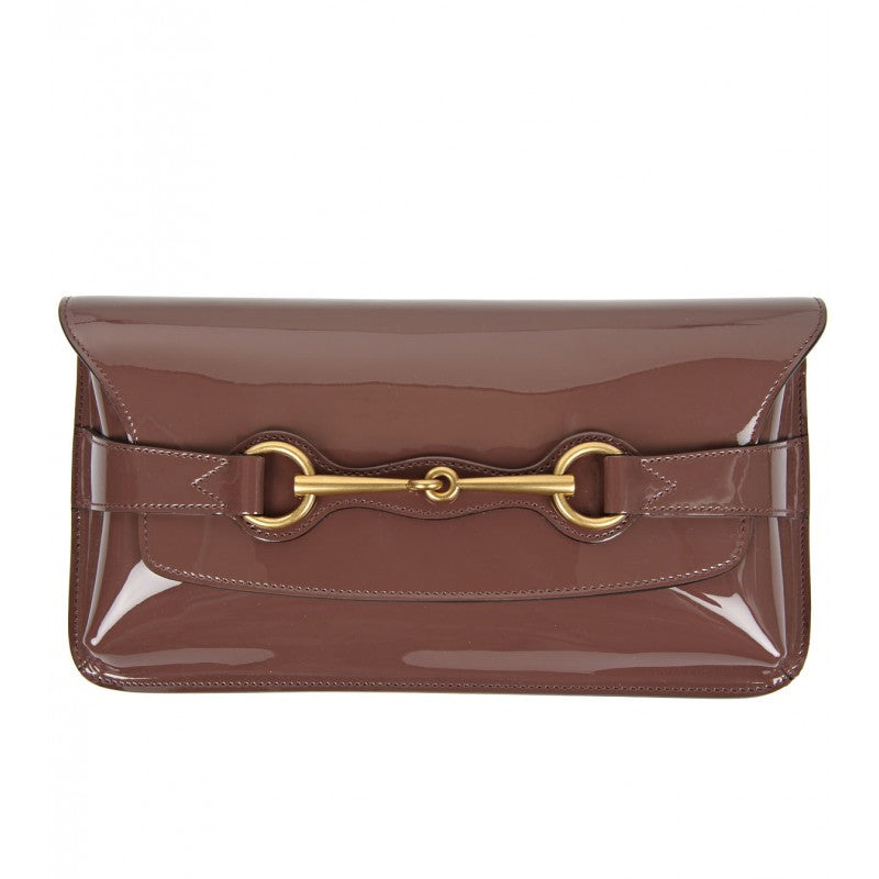 Mauve bright bit patent leather clutch bag