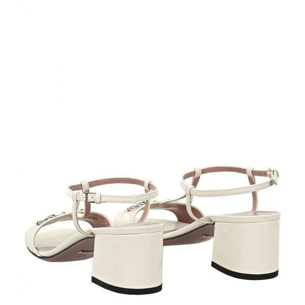 Off-white patent t-strap horsebit sandals