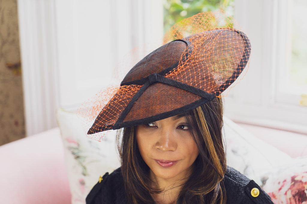 black and orange saucer hat fascinator