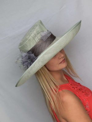 Milly - Large mint green formal hat with an upturned brim.