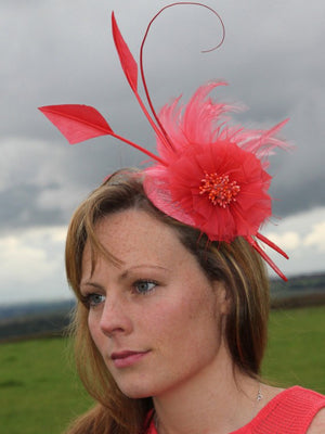 Arabella - Make a statement with this gorgeous coral fascinator consists of a beautiful flower made from feathers, encrusted with beads.