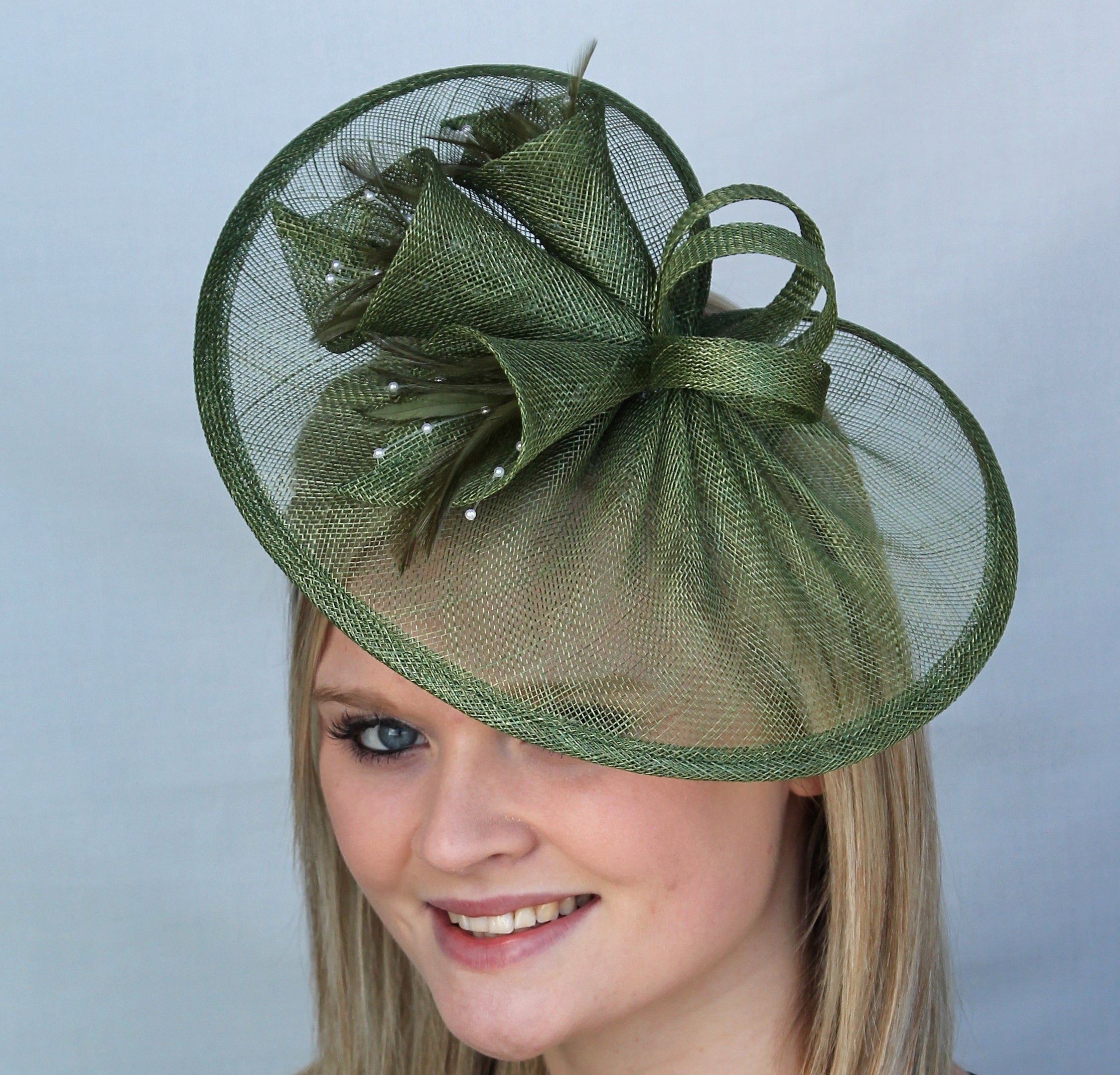 dark green sinamay fascinator, trimmed with sinamay lillies. Perfect for a wedding