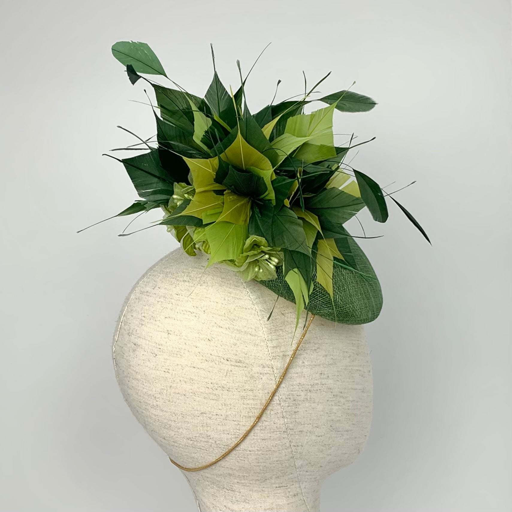 green feather hat