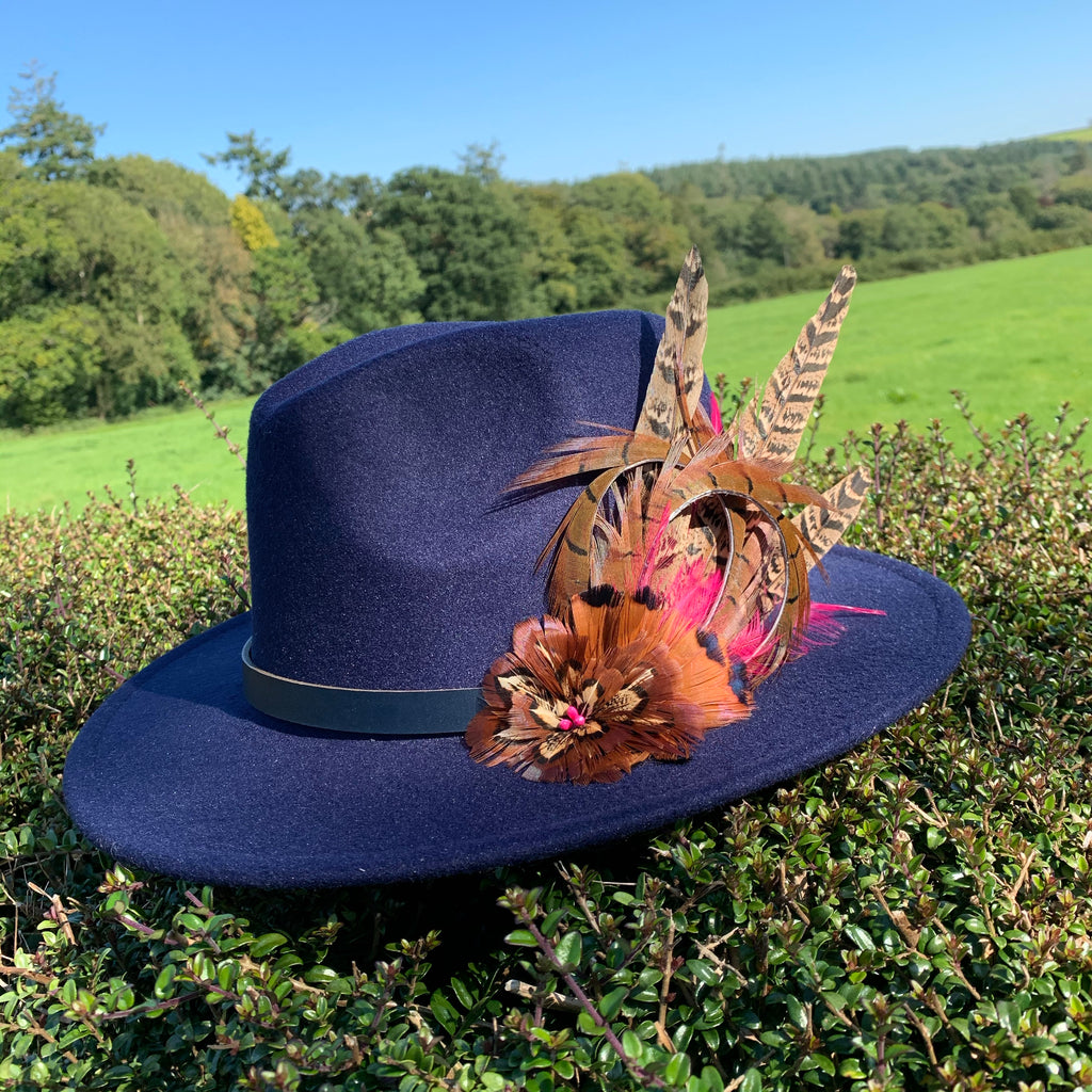 Navy fedora embellished with natural game bird feathers