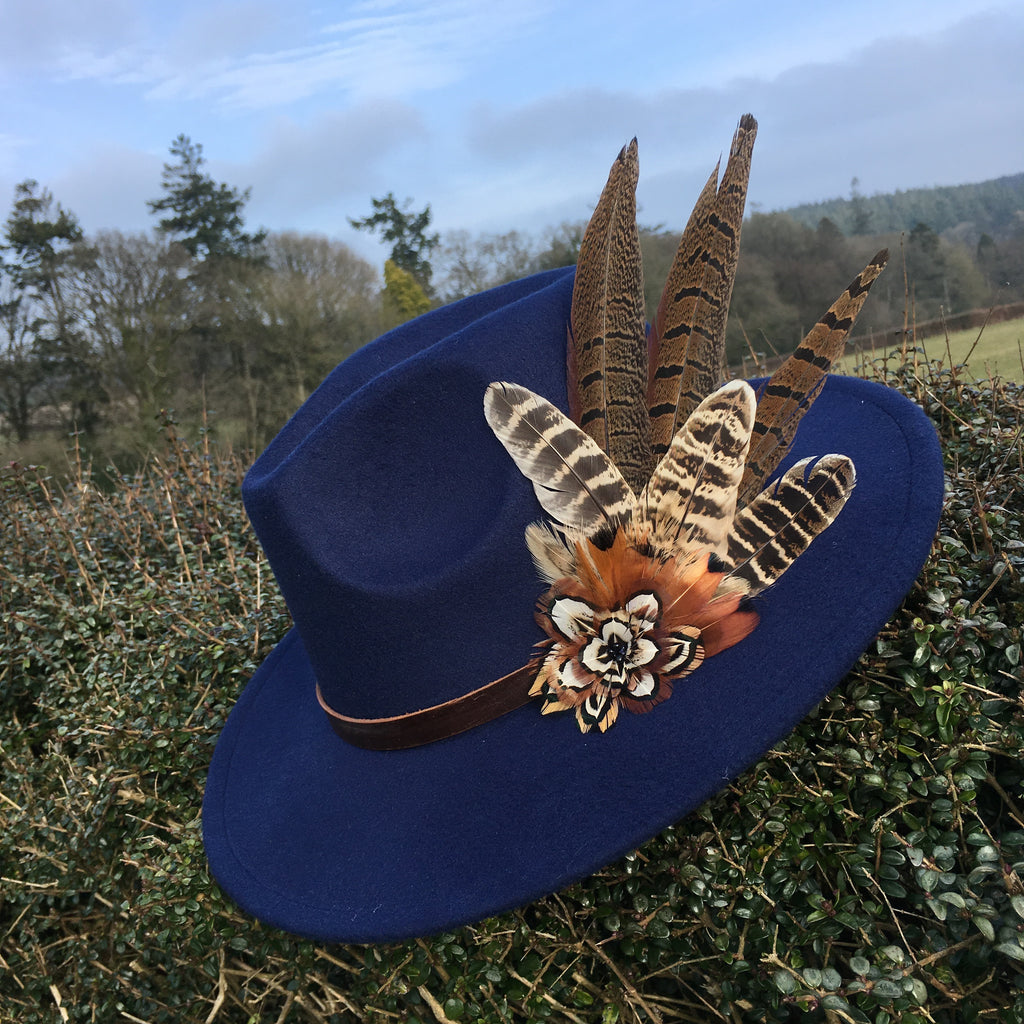 navy felt fedora with game bird feathers