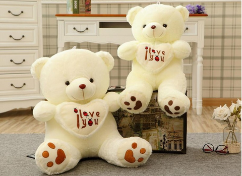 two white color teddy bear
