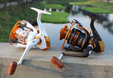 white and black colors yumoshi fishing reels