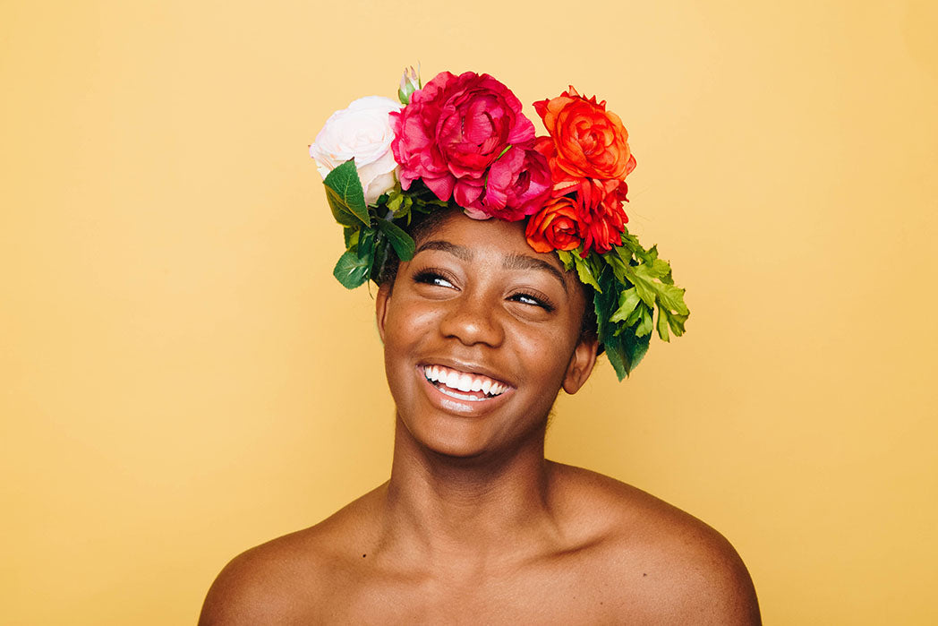 smiling young woman with flowers on the head