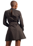 Backside view of girl wearing black dress from Naturelle
