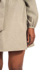 Leg length view of Naturelle khaki dress