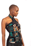 Woman in profile with turquoise ethnic halter neck top by African Renaissance