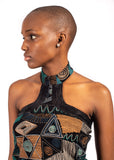 Portrait of woman looking to the right wearing turquoise African Renaissance choker top