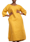 Full body image of a woman wearing a yellow linen dress by Baroque Clothing