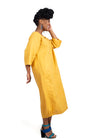 Side view of a woman wearing a yellow linen dress by Baroque Clothing Cape Town