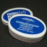 Bottom view of the night conditioner balm tin with the label with product description and ingredients