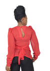 Back view of ruffled, red blouse by Judith Atelier.