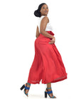 Side view of beautiful woman wearing stylish red culottes by Judith Atelier.