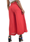 Stylish red, wide legged trousers by Judith Atelier.