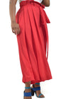Trendy, red, wide legged trousers with elegant belt detail by Judith Atelier.