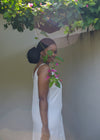 Side view of white drawstring dress outdoors by Judith Atelier.