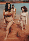Female models wearing Beige/Burnt Sienna reversible bikini sets by Nude Wear Clothing.