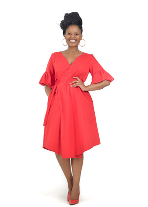 Smiling female model wearing stylish red wrap dress by Her Ritual.