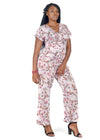 Woman wearing soft pink floral jumpsuit by Julietta by Romeo.