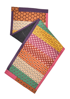 Bent, striped shweshwe patterned table runners by Totoma.
