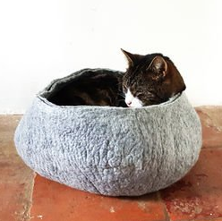 cat asleep in basket, christmas gift ideas for cats