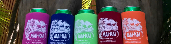 Collection of koozies in five colors in front of King Kai Tiki in the Mai-Kai Garden
