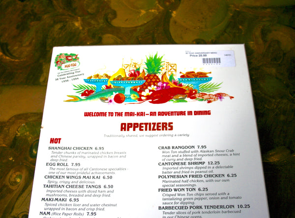 Close up view of the Mai-Kai 38 year anniversary vintage food menu