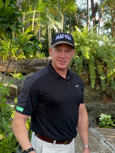 Handsome male model in garden wearing a Mai-Kai classic style baseball cap in black & floral