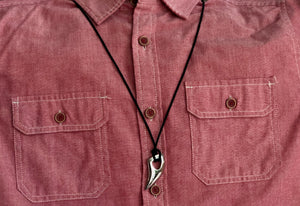 Silver Tooth Necklace around dress shirt