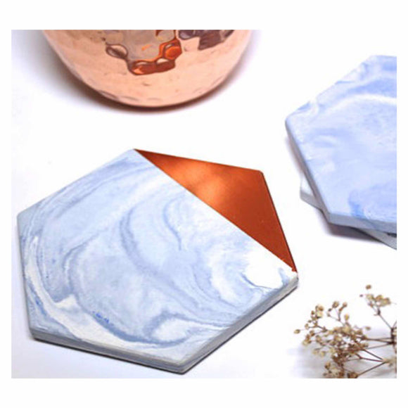 Concrete coasters, blue marble effect with copper or gold corner.